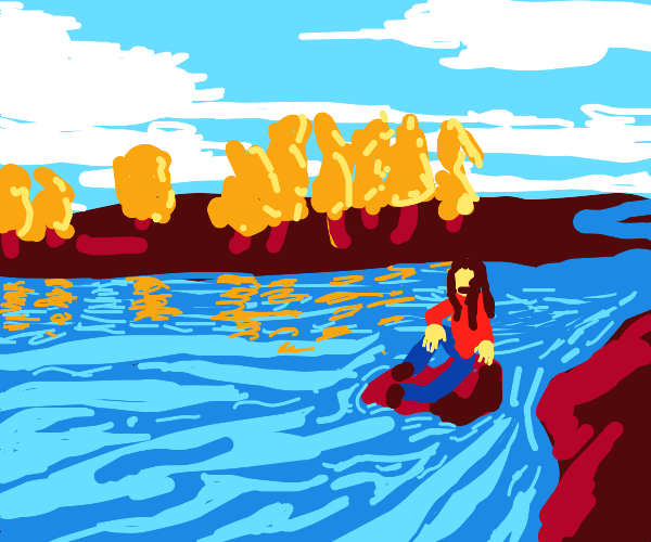 sitting by a river in the fall