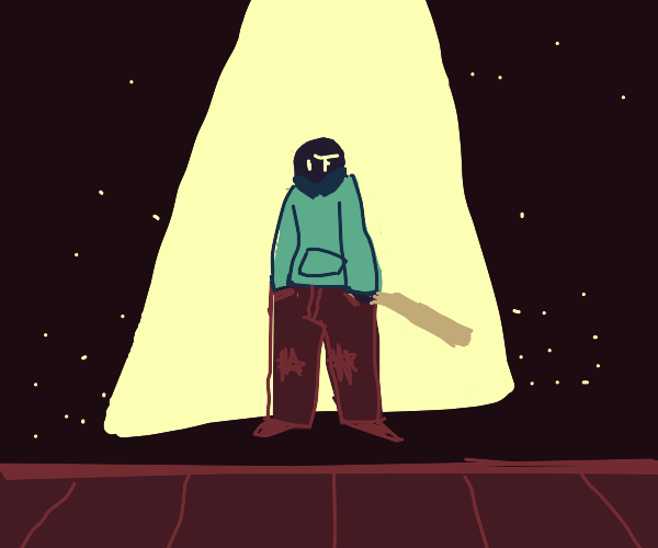 man in the spotlight with a baseball bat