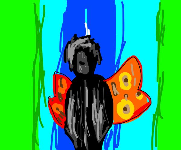 Black man grows butterfly wings!