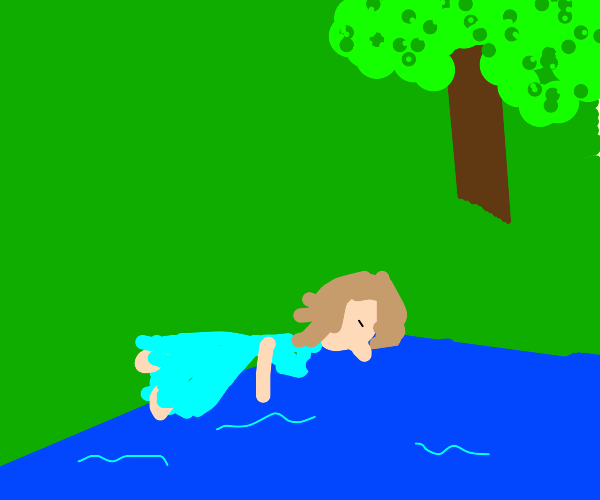 Woman lying on the edge of a riverbank
