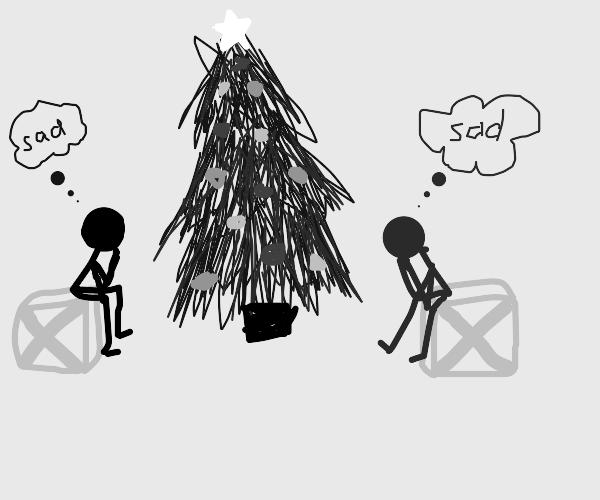 2 sad people and Christmas tree