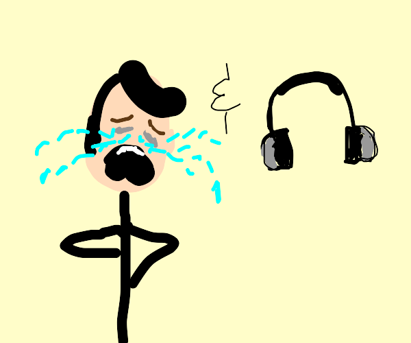 Crying person and pair of earphones.