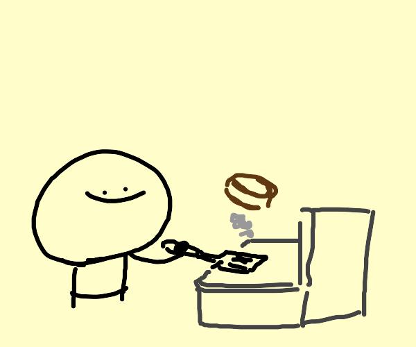 guy cooking hamburgers