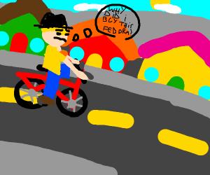 Boy on bike regrettably looks at hat