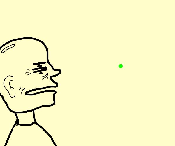Old man looks at green dot