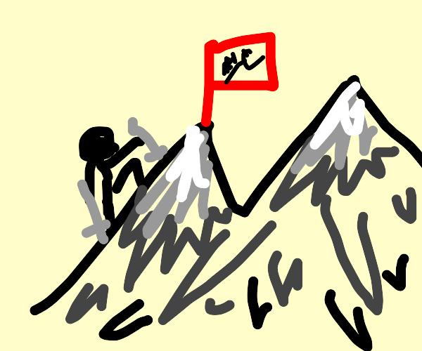 guy is climbing mountain
