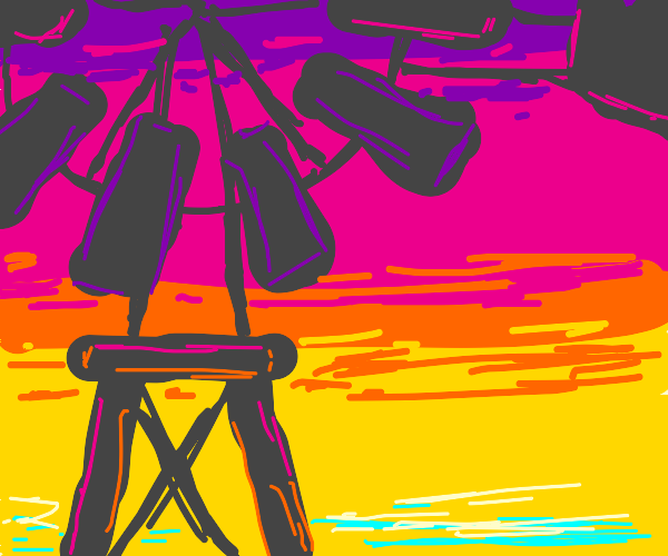 old windmill in sunset