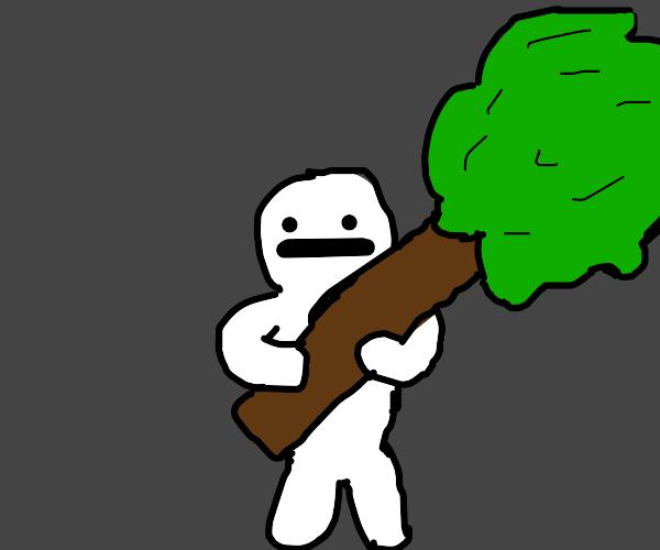 Man holding a tree