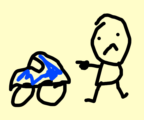 Man pointing at Blue Beetle car