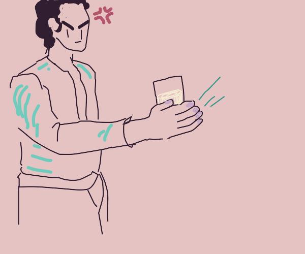 Man slaps his glass of milk