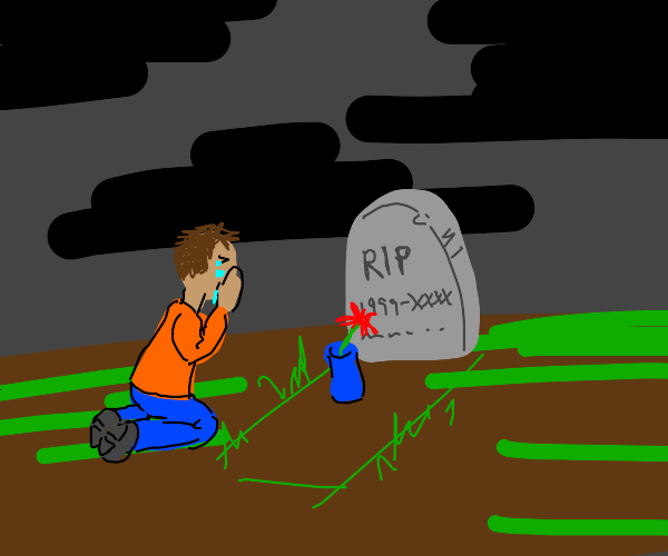 Man is crying at someone's grave
