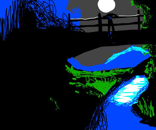 depressed man on a bridge at night