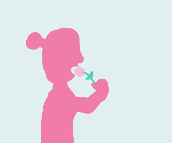 Woman eating flowers