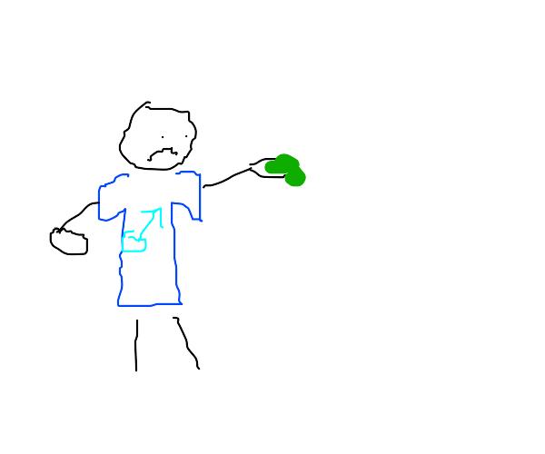 A man got goop on his hand! His shirt has him