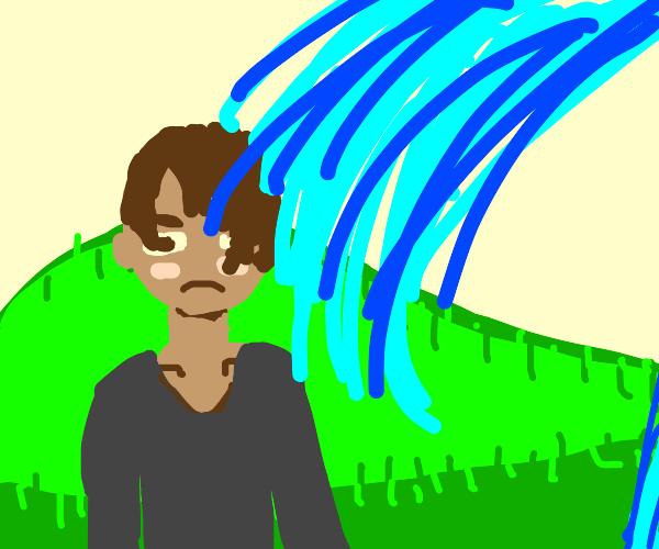 Geyser getting a man wet. Looks unamused.