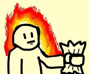 Burning man holding paper