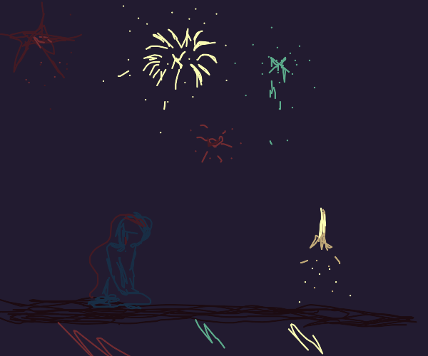 Sad crouched person with fireworks in bg