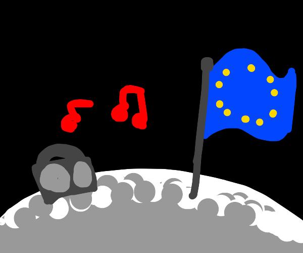 A radio plays near a UN flag on the moon