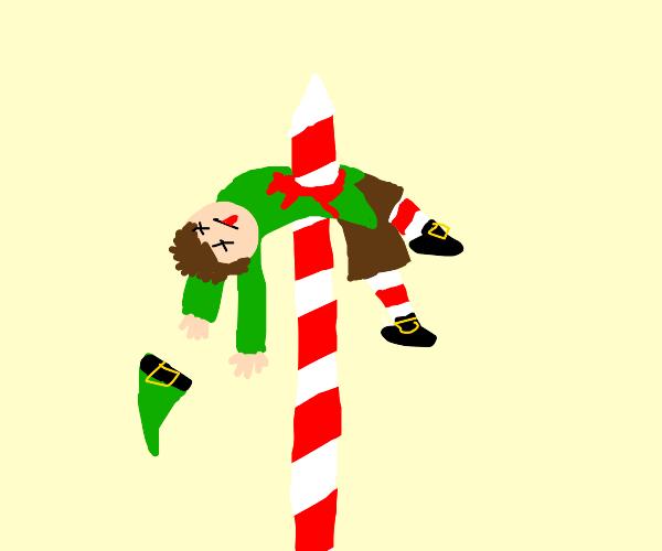 Xmas elf impaled on the North Pole!