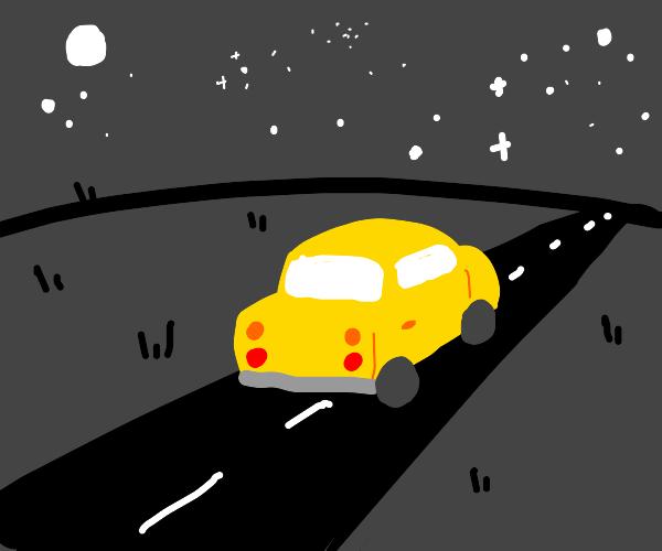 Yellow car driving at night