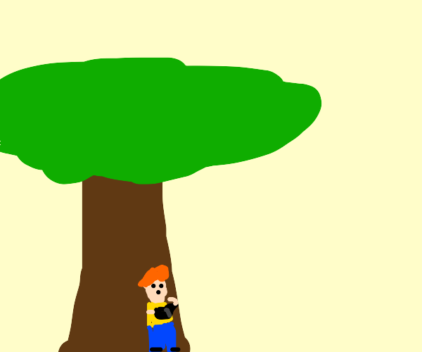 A happy kid reading a book under a tree