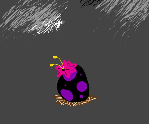 Purple-black egg holding flowers