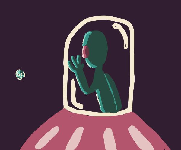 alien looking through a window