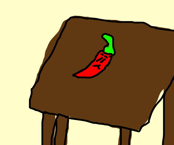 a chili pepper sits at a table, alone