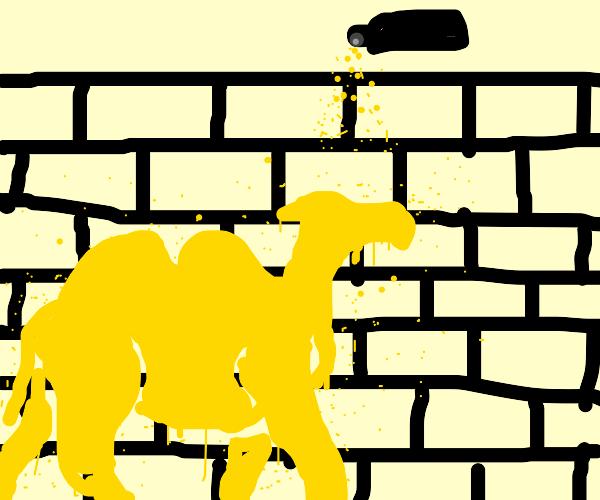 The camel is graffiti on a brick wall