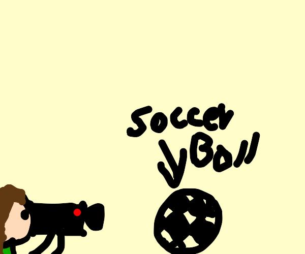 Man filming a soccer ball