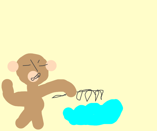 Monkey brushing a puddle in grass