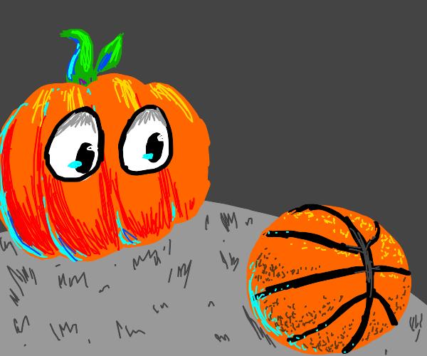 pumpkin looking at a basketball