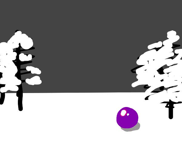 Purple sphere abandoned in a snowy field