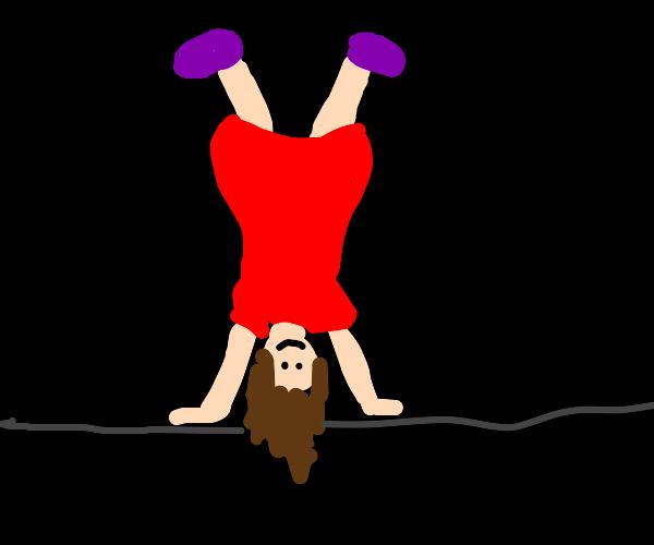 lady in red dress n prpl shos doing cartwheel