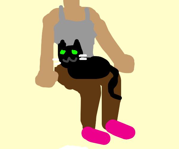 cat in women's lap