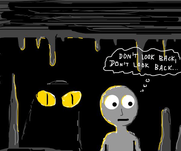 dude in dark cave with glowing eyes behind