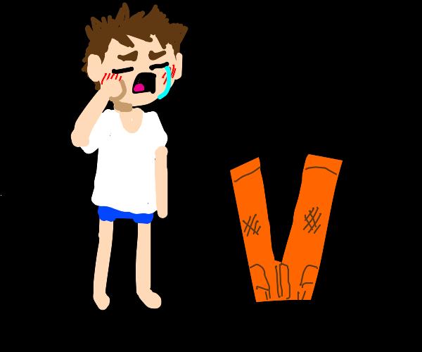 Sad boy with flipped orange pants