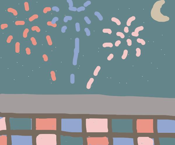 A disco floor under some fireworks