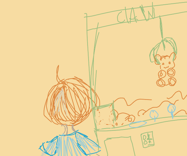 boy using a claw machine