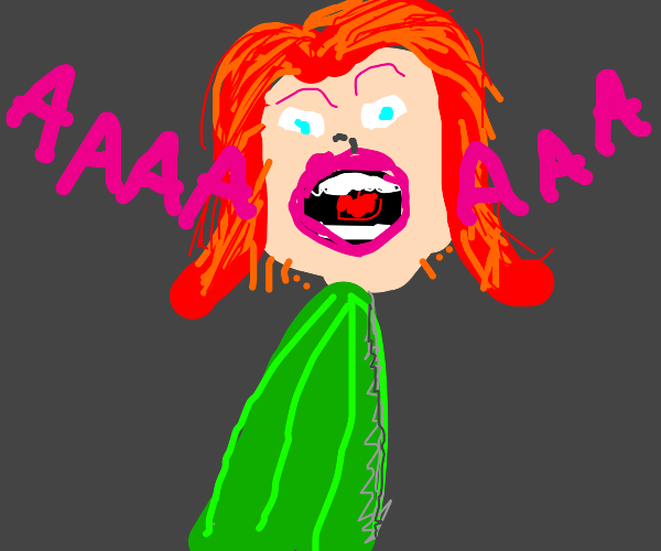 Ginger woman scared by cucumber