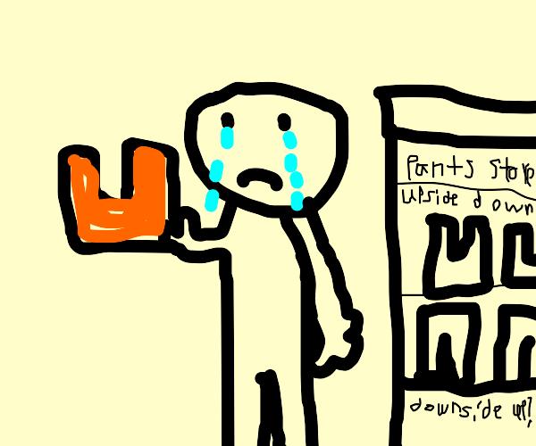 Boy cries bcuz orange pants on upsidedown