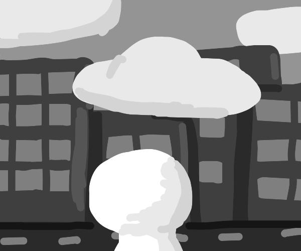 man stares at abandoned city