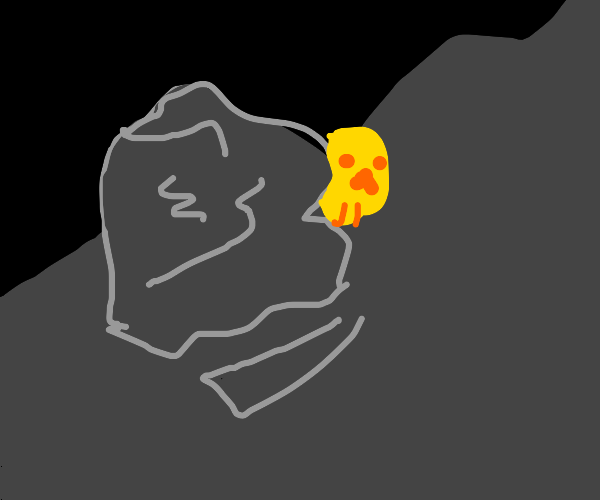 Gold skull hides behind rock in the mountains