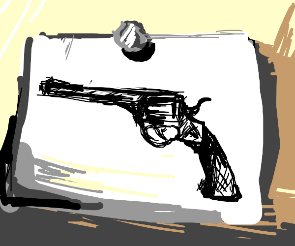 Gun on a piece of paper