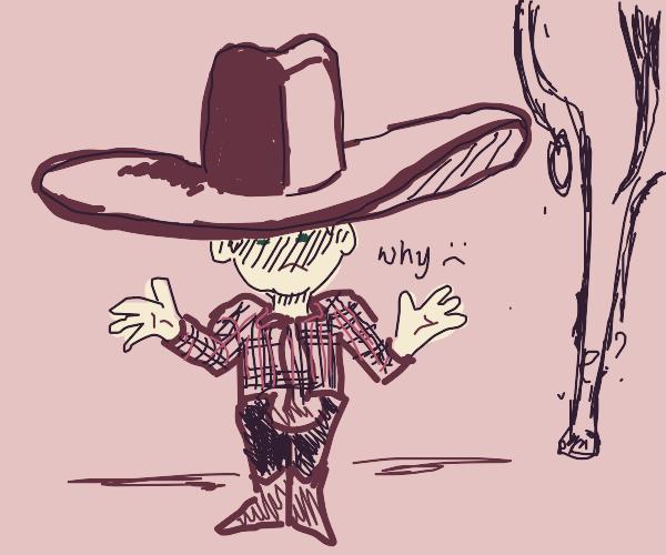 Mini cowboy overwhelmed by his big hat