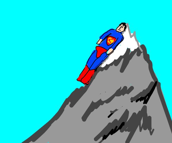 superman sleeping flat on a mountain peak