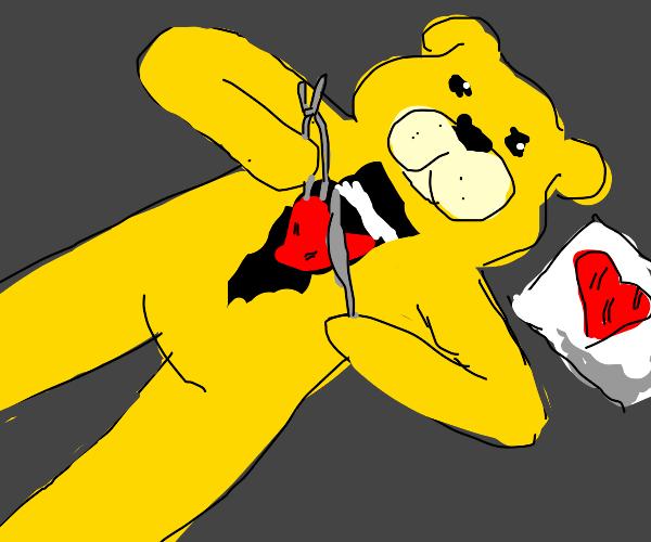 Yellow bear performing self heart transplant