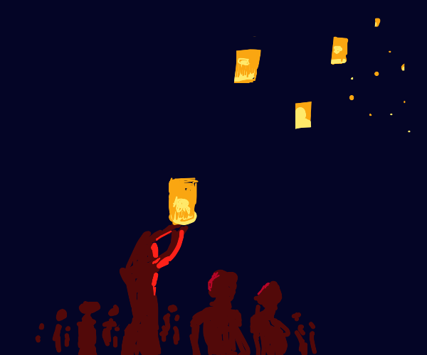 people releasing lanterns into the sky