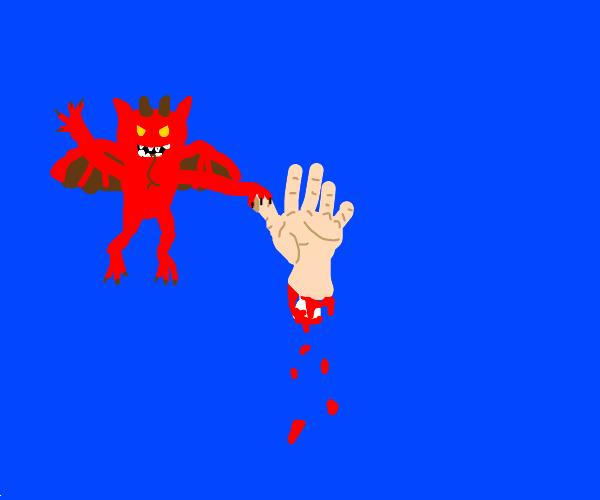 Little imp holding a severed hand