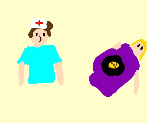 A nurse looking at a preg lady preg w/ cookie